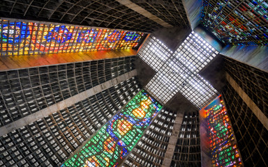 Poster Rio de Janeiro Rio de Janeiro Cathedral, Brazil, with its brutalist concrete structure interior decorated by brightly colored stained glass windows.