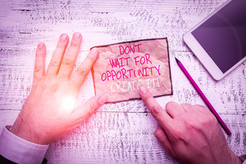 Handwriting text writing Don T Wait For Opportunity Create It. Conceptual photo work hard on yourself and begin from this moment Hand hold note paper near writing equipment and modern smartphone