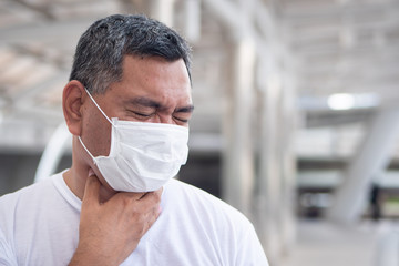 allergic sick old man having sore throat inflammation; concept of man with allergy, phlegm, sore throat or throat inflammation, influenza, flu, cold, sickness, health care concept