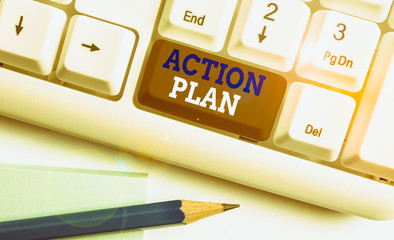 Conceptual hand writing showing Action Plan. Concept meaning detailed plan outlining actions needed to reach goals or vision White pc keyboard with note paper above the white background
