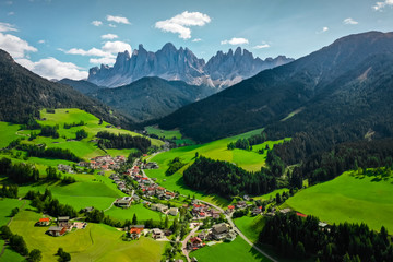 Beautiful Aerial Photography Lanscape with Italian Dolomites and Green Meadow Village