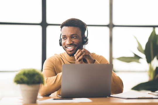 Happy black manager working in call centre