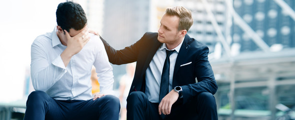 Two Caucasian businessmen sit in city. Unemployment concerns And work unsuccessfully as the employer wants. Stress caused by overload And the economic recession of the world. Social security concept