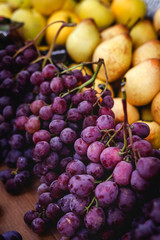 street market of assortment of fresh fruits and vegetables.Healthy food.Organic. farming. grapes; pears
