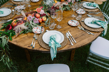 Wedding table decoration in rustic style placed outdoors Fotobehang