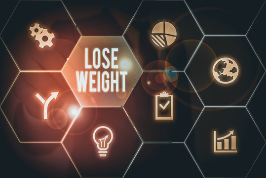 Writing note showing Lose Weight. Business concept for the fact of a demonstrating s is or an animal s is body weight becoming less
