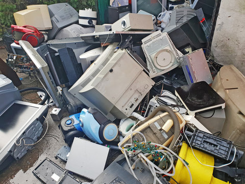 Pile of used electronic and housewares waste