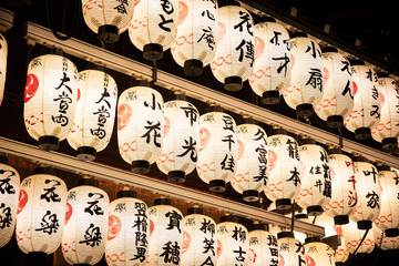 Japan,?Kyoto?Prefecture,?Kyoto?City,?Rows of lanterns glowing in Japanese temple?at night