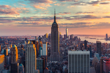 USA, New York, New York City, View of Manhattan skyscrapers at sunset Fototapete