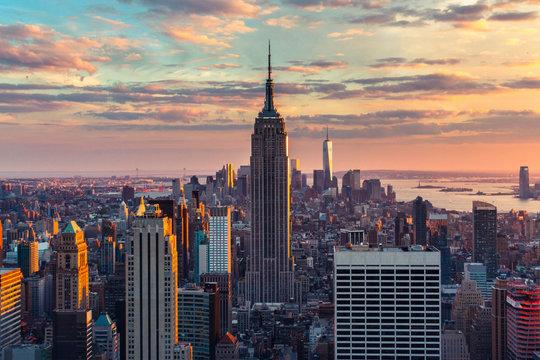 USA, New York, New York City, View of Manhattan skyscrapers at sunset