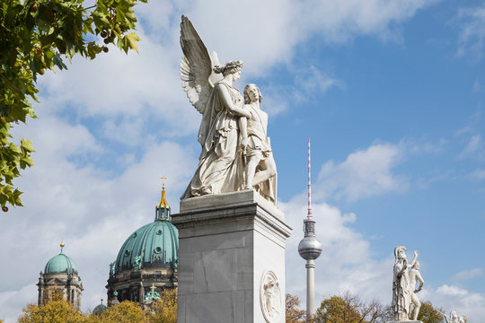 Germany, Berlin, Nike Assists Wounded Warrior statue with Berlin Cathedral and Berlin TV Tower in background