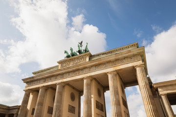 Foto op Plexiglas Historisch mon. Germany, Berlin, Low angle view of?Brandenburg Gate?standing against clouds