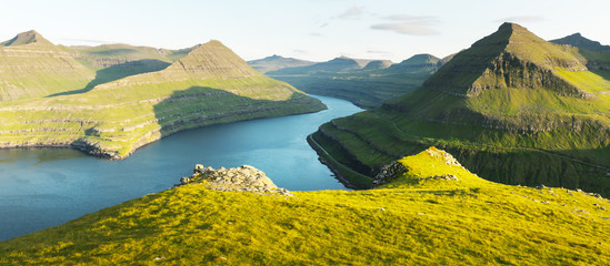 Panorama over majestic sunny fjords of Funningur, Eysturoy island, Faroe Islands. Landscape photography