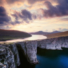 Incredible view of Sorvagsvatn lake on cliffs of Vagar island in sunset time, Faroe Islands, Denmark. Landscape photography