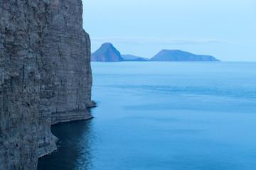 Evening view of islands in Atlantic ocean. Faroe Islands, Denmark. Landscape photography