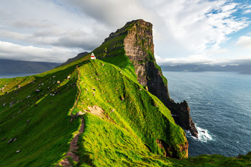 Kallur lighthouse on green hills of Kalsoy island, Faroe islands, Denmark. Landscape photography