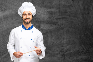 Cheerful chef on a black chalkboard, you can put a menu on it