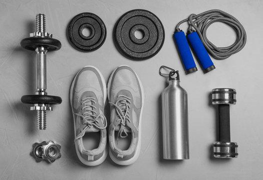 Gym equipment on light grey background, flat lay