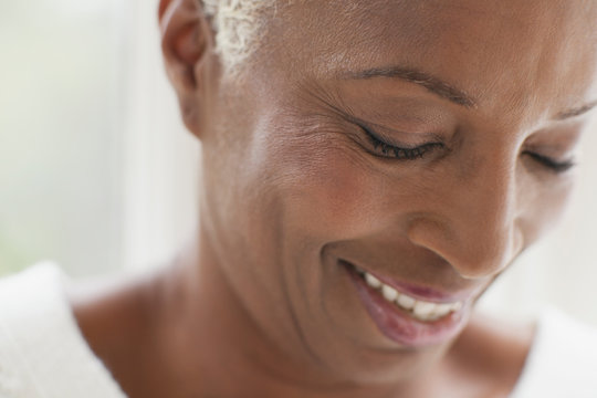 Close up of middle aged woman with eyes closed