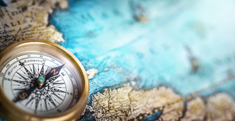 Magnetic compass on world map.Travel, geography, navigation, tourism and exploration concept background. Macro photo. Very shallow focus. Wall mural