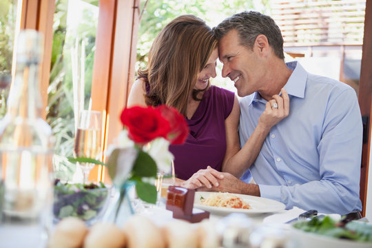 Couple being affectionate at dinner
