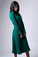 Beautiful face of african-american model on photoshoot. Model wearing a bottle green color and lots fabulous.