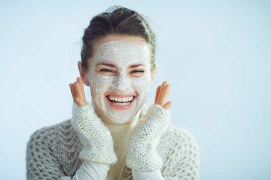happy modern woman with white facial mask