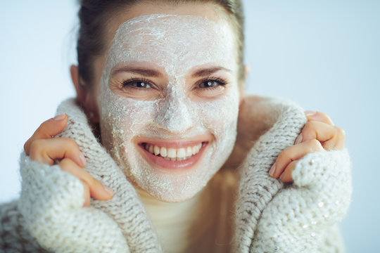 smiling woman with white facial mask covering in clothes
