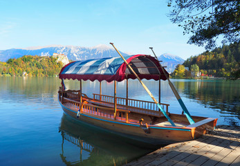 Traditional Slovenian Boat at the Dock of Lake Bled in the Fall