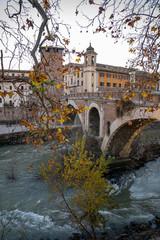 Cityscape with bridge over the Tiber river and Tiberina island in Rome, Italy