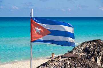 Cuba flag on a background of the sea. Flag of Cuba moving in the wind.