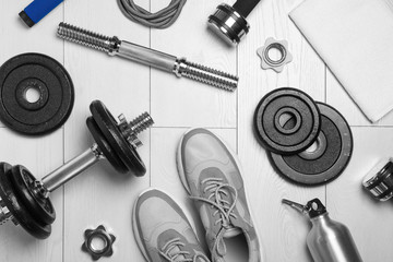 Foto op Aluminium Europa Gym equipment and shoes on wooden floor, flat lay