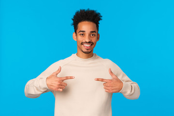 I am the one. Cheerful and friendly confident lucky african american male with hipster afro...