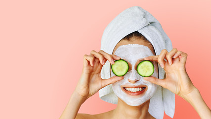 Printed kitchen splashbacks Spa Cosmetology, skin care, face treatment, spa and natural beauty concept. Woman with facial mask holds slices of cucumber.