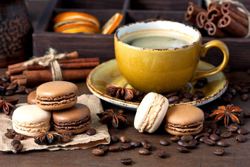 French macarons with coffee mug
