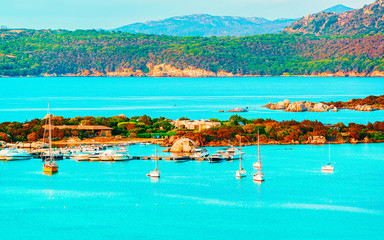 Acrylic Prints Turquoise Landscape and scenery of Golfo Aranci at Costa Smeralda, Sardegna island in Italy in summer. Sassari province near Olbia and Cagliari. In Mediteranean sea. Yachts, boats and ships. Mixed media.