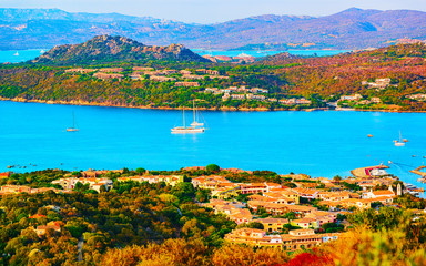 Poster Blauw Landscape and scenery of Golfo Aranci at Costa Smeralda, Sardegna island in Italy in summer. Sassari province near Olbia and Cagliari. In Mediteranean sea. Yachts, boats and ships. Mixed media.