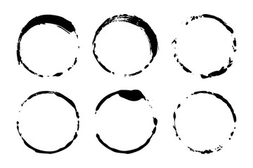 Set of grunge circles of wine or coffee stains. Vector round shapes. Dirty textures of banners, boxes, frames