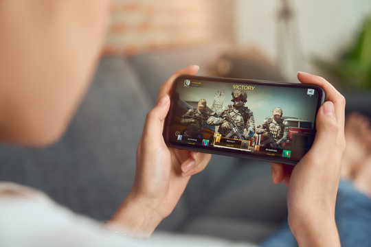 Bangkok, Thailand - January 15, 2020 : Hand holding smartphone and play game call of duty on mobile.