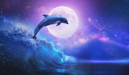 Night ocean with playful dolphin leaping from sea on surfing wave and full moon shining on tropical background