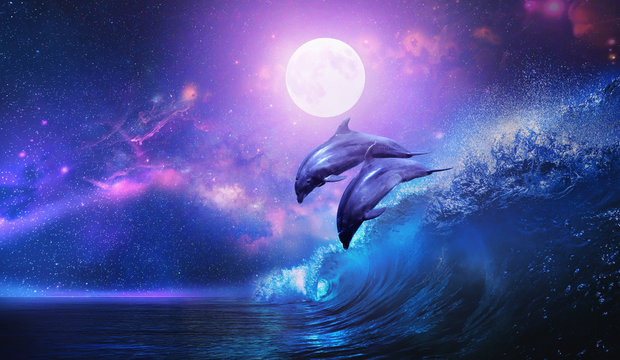 Night ocean with a pair of beautiful dolphins leaping from sea on surfing wave and full moon shining on tropical background