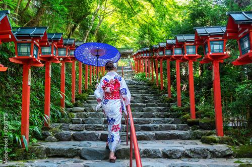 Wall mural Asian woman wearing japanese traditional kimono at  Kifune Shrine in Kyoto, Japan.