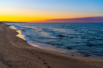 Sea beach in sunset colors