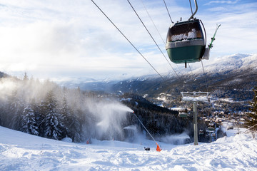 Wall Murals Gondolas Whistler, British Columbia, Canada. Gondola going up the mountain during a vibrant and sunny winter day.