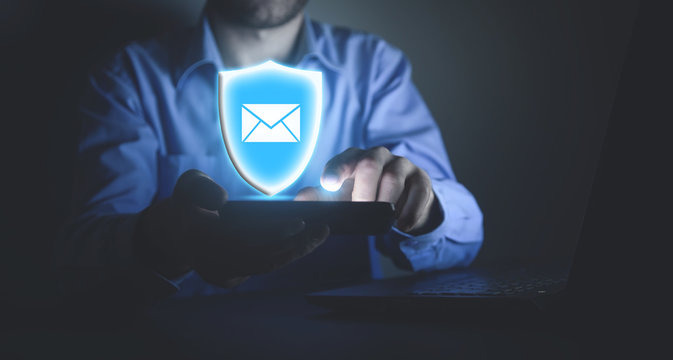 Man using smartphone. Protect email. Security