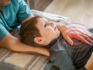 Real osteopath does physiological and emotional therapy for child. Osteopathy Treatment.