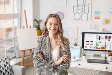 Portrait of female interior designer in office Wall mural