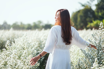 Portrait image of an asian woman in a beautiful Cutter flower field