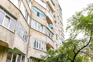 Fotobehang Oost Europa Rivne, Ukraine Soviet architecture city in western country with old apartment flat building exterior and Ukrainian flag