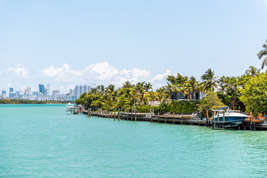 Bal Harbour, Miami Florida with light green turquoise ocean Biscayne Bay Intracoastal water and cityscape skyline of Sunny Isles Beach